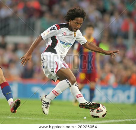 BARCELONA - OCT 3: de Guzman of Mallorca in action during spanish league match between FC Barcelona and RCD Mallorca at Nou Camp Stadium in Barcelona, Spain. October 3, 2010