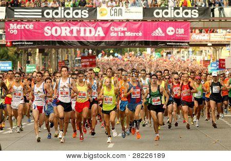 BARCELONA - SEPT 28: Runners on start of Cursa de la Merce popular race in Montjuich Mountain on September 28, 2009 in Barcelona, Spain