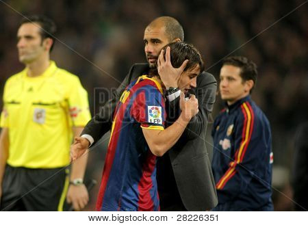 BARCELONA - JAN 2: Josep Guardiola & Bojan of Barcelona during a Spanish League match between FC Barcelona and UD Levante at the Nou Camp Stadium on January 2, 2011 in Barcelona, Spain
