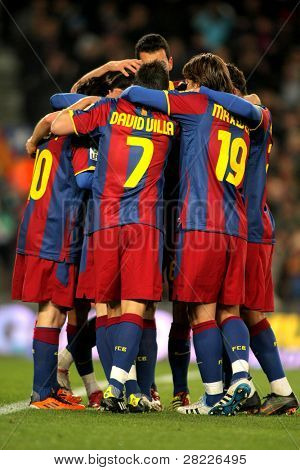 BARCELONA - JAN 22: Players group of FC Barcelona celebrate goal during a Spanish League match between FC Barcelona and Racing at the Nou Camp Stadium on January 22, 2011 in Barcelona, Spain