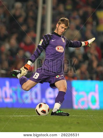 BARCELONA - FEB 5: David de Gea of Atletico Madrid during the match between FC Barcelona and Atletico Madrid at the Nou Camp Stadium on February 5, 2011 in Barcelona, Spain