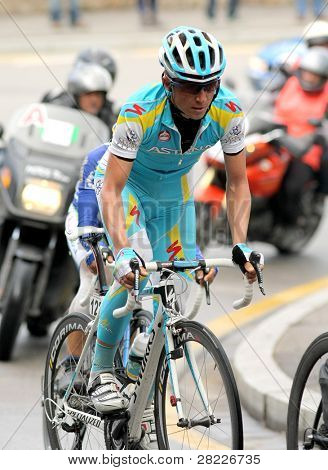 BARCELONA - MARCH 27: Pro Team Astana's cyclist Russian Evgeni Petrov rides with the pack during the Tour of Catalonia cycling race in Barcelona on March 27, 2011