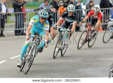 BARCELONA - MARCH 27: Pro Team Astana's cyclist Russian Evgeni Petrov rides with the pack during the Tour of Catalonia cycling race in Barcelona, Spain on March 27, 2011