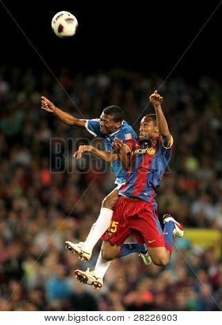 BARCELONA - APRIL 9: Kale Uche(L) of Almeria fights with Keita(R) of Barcelona during the match between FC Barcelona and UD Almeria at the Nou Camp Stadium on April 9, 2011 in Barcelona, Spain