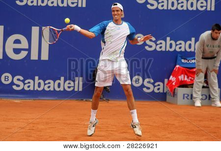 BARCELONA - APRIL 19: Argentinian tennis player Juan Ignacio Chela in action during the first round match of the Barcelona tennis tournament Conde de Godo on April 19, 2011 in Barcelona