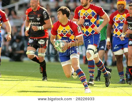 BARCELONA - APRIL 9: Perpignan's fullback Porical drives the ball during the Heineken European Cup match USAP Perpignan against RC Toulon at the Olympic Stadium in Barcelona, on April 9, 2011