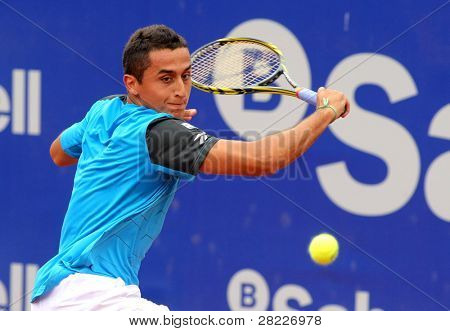 BARCELONA - APRIL 20: Spanish tennis player Nicolas Almagro in action during his match against Pablo Andujar of Barcelona tennis tournament Conde de Godo on April 19, 2011 in Barcelona