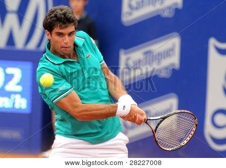 BARCELONA - APRIL 20: Spanish tennis player Pablo Andujar in action during his match against Nicolas Almagro of Barcelona tennis tournament Conde de Godo on April 20, 2011 in Barcelona