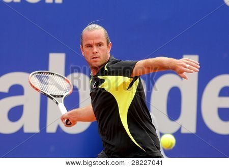 BARCELONA - APRIL 19: Belgian tennis player Xavier Malisse in action during his match against Ferrero of   Barcelona tennis tournament Conde de Godo on April 19, 2011 in Barcelona, Spain