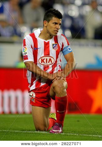 BARCELONA - APRIL 17: Kun Agaero of Atletico Madrid in action during a Spanish League match between Espanyol and Atletico Madrid at the Estadi Cornella on April 17, 2011 in Barcelona, Spain