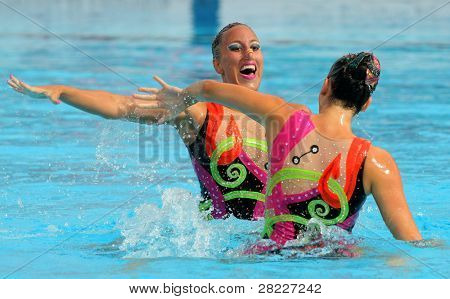 BARCELONA - June 18: Greeks synchro swimmers Despoina Solomou and Neftaria Ramnioti in a Duet exercise during the Espana Sincro meeting in Barcelona Picornell pool, June 18, 2011 in Barcelona, Spain