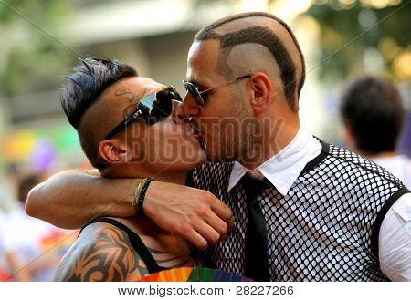 BARCELONA - JUNE 26: Two unidentified young men kiss during the annual Barcelona Gay and Lesbian Pride Festival on June 26, 2011 in Barcelona, Spain