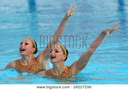 BARCELONA - JUNE, 18: French synchro swimmers Sara Labrousse and Chloe Willhelm in a Duet exercise during the Espana Sincro meeting in Barcelona Picornell Swimpool, June 18, 2011 in Barcelona, Spain