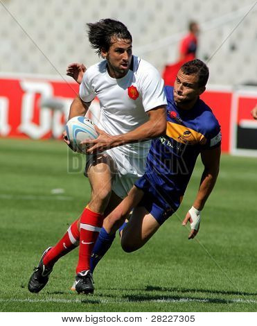 BARCELONA - JULY 9: Paul Albadalejo of France drives the ball during the match of Rugby7 European Champìonship between France and Romania at the Olympic Stadium in Barcelona, on July 9, 2011