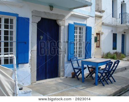 Greece House,Blue Shutters And Table.