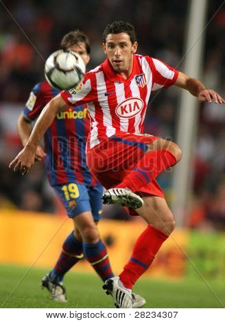BARCELONA - SEPTEMBER 19: Argentinean player Maxi Rodriguez during Spanish league match between Barcelona vs Atletico de Madrid at the New Camp Stadium on September 19, 2009 in Barcelona, Spain.