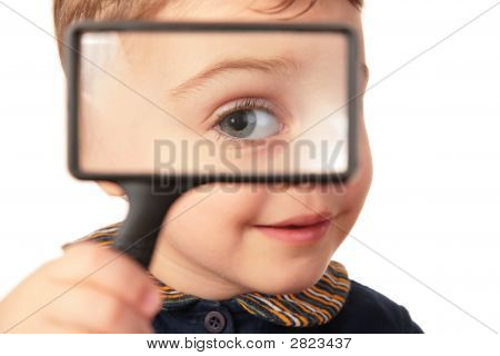 Smiling Child Looks Through Magnifier