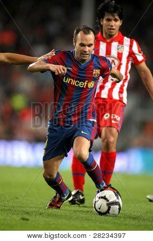 BARCELONA - SEPTEMBER 19: Andres Iniesta of Barcelona during Spanish league match between Barcelona vs Atletico de Madrid at the New Camp Stadium on September 19, 2009 in Barcelona, Spain.