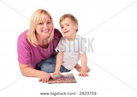 Middleaged Woman In Pink Shirt With Child