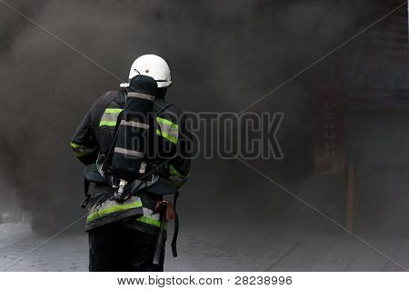 Firefighter going to rescue in a smoke