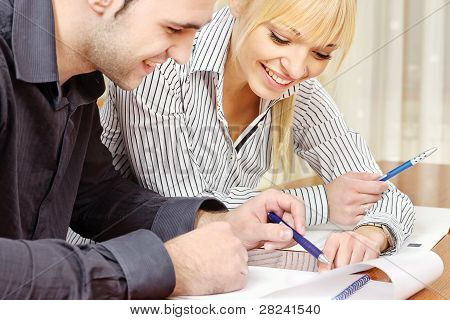Young Business Couple Work In Office