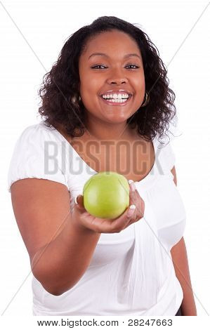 Young African American Woman Giving An Green Apple