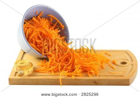The Polished Carrots On A Board On A White Background.