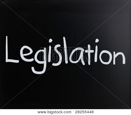 "The Word ""legislation"" Handwritten With White Chalk On A Blackboard"