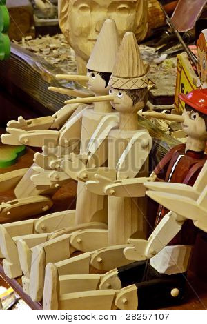 ROME - JULY 8: Tourists visit the  studio of  woodcarver named Geppetto on July 8 2011, Rome. The Adventures of Pinocchio, by Carlo Collodi, are one of the most famous children's novel in the world.
