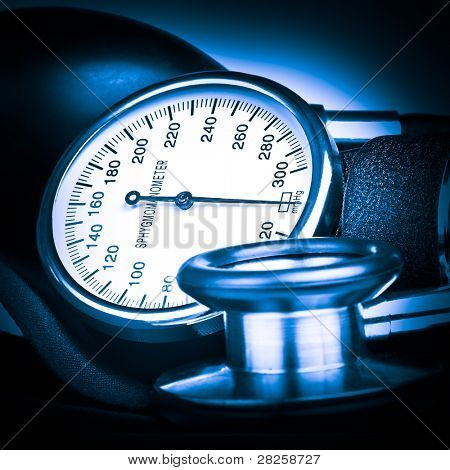 Blue toned sphygmomanometer and stethoscope kit used to measure blood pressure