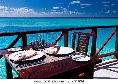 Table setting at tropical beach restaurant