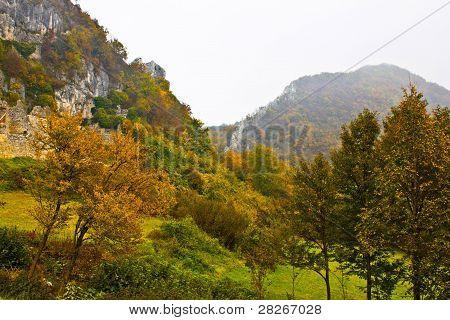 Autumn View Of Mountain Ridge In Fog