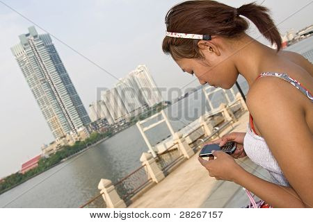 Woman with cellular telephone
