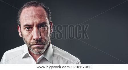 Portrait Of A Thinking Businessman