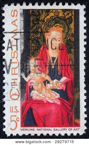 UNITED STATES OF AMERICA - CIRCA 1982: A greeting Christmas stamp printed in USA shows draw by artist Memling - Madonna and Child, circa 1982