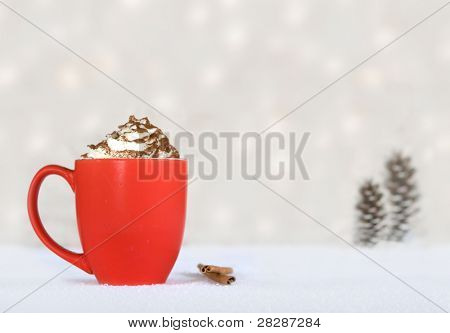 hot chocolate in a red mug on a winter background