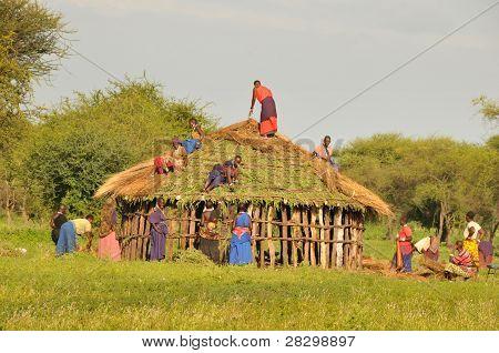 Lake Manyara, Tanzania, December 21, 2011, Masai women building a hut
