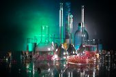 Pharmacy And Chemistry Theme. Test Glass Flask With Solution In Research Laboratory. Science And Med poster