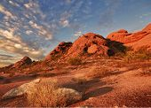 foto of chola  - Beautiful desert landscape with red rock buttes and gorgeous summer glowing sky wit little fluffy clouds - JPG