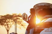 Independent Travel.young Woman Traveler With A Luggage poster