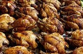 stock photo of spit-roast  - spit roast chicken on the market - JPG