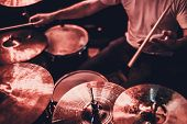 Music, People, Musical Instruments And Entertainment Concept - Male Musician Or Drummer Playing Drum poster
