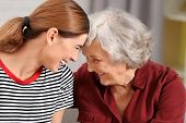 Elderly Woman With Female Caregiver On Blurred Background poster