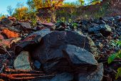 A Heavy Rocks On Autumn Nature Landscape Background. Heavy Grey Cobblestone Lying On The Ground. Gro poster