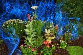 foto of magickal  - green garden with lots of flowers and fake blue smoke created by el wire - JPG