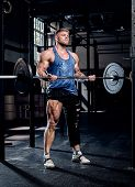 A Strong Bodybuilder With A Bandage On A Leg, Doing Exercises With Light Weights, Recovery After Inj poster