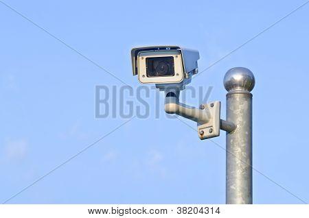 Security Camera On Blue Sky