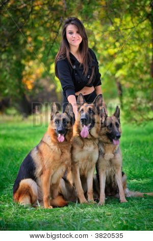 Teenage Girl With Three Dogs