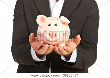 Piggybank In Businessman Hands