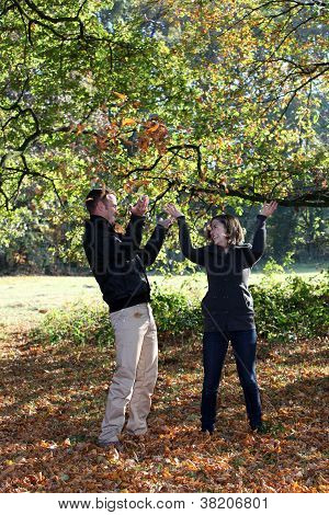 Young Couple Enjoying The Autumn Forest